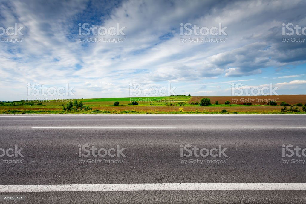 Country road with field on horizon, side view. stock photo