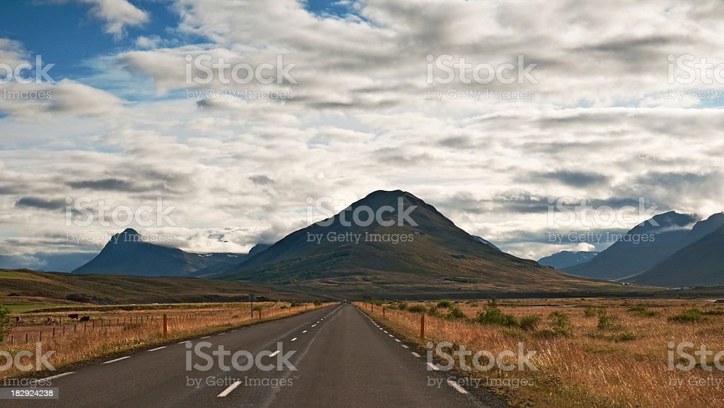 Country road with hill on Iceland stock photo