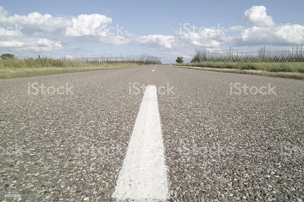 country street with fields and clouds royalty-free stock photo