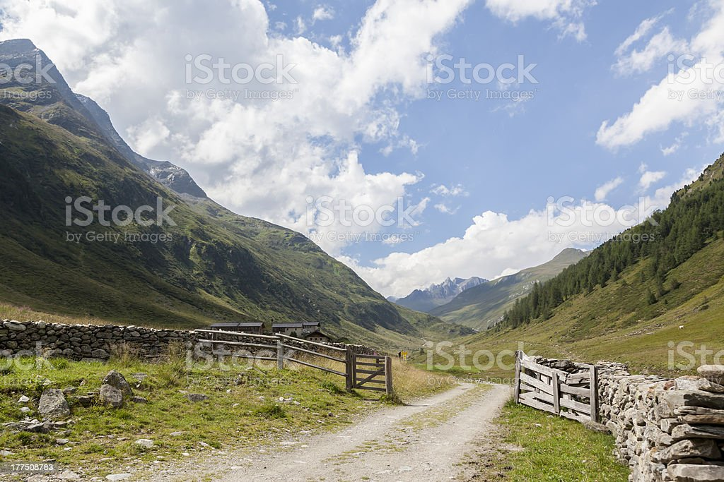 Country trail in alpine mountain valley, Austria. stock photo