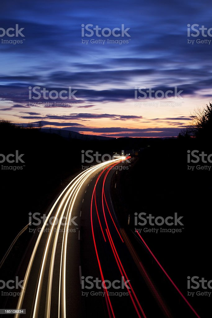 Countryroad at dusk, long exposure stock photo