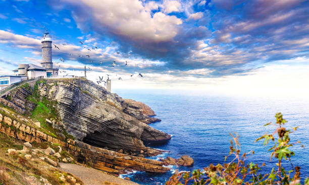 Countryside and cliif in Santander.Tour tourism in Cantabria,Spain. Beautiful natural  landscape Cabo Mayor Lighthouse.Scenery coastline and evening sky. santander spain stock pictures, royalty-free photos & images
