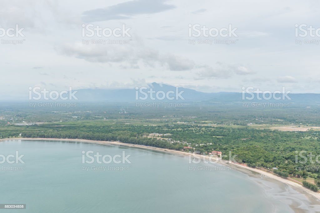 Countryside area with sea mountain and cloudy sky on background. stock photo