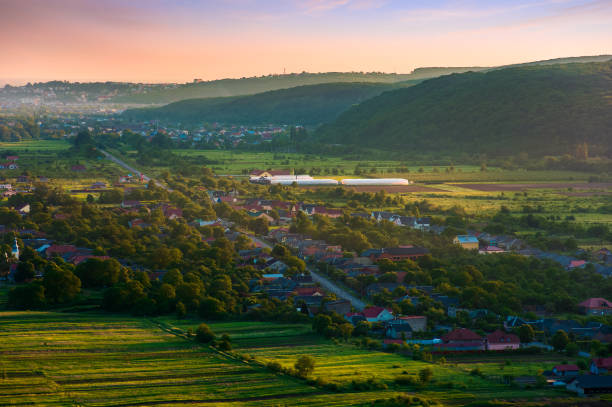 countryside in mountains red dusk in springtime stock photo