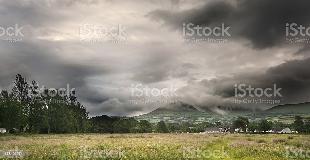 Countryside landscape image across to mountains in distance stock photo