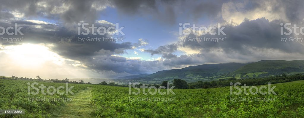 Countryside landscape panorama across to mountains stock photo