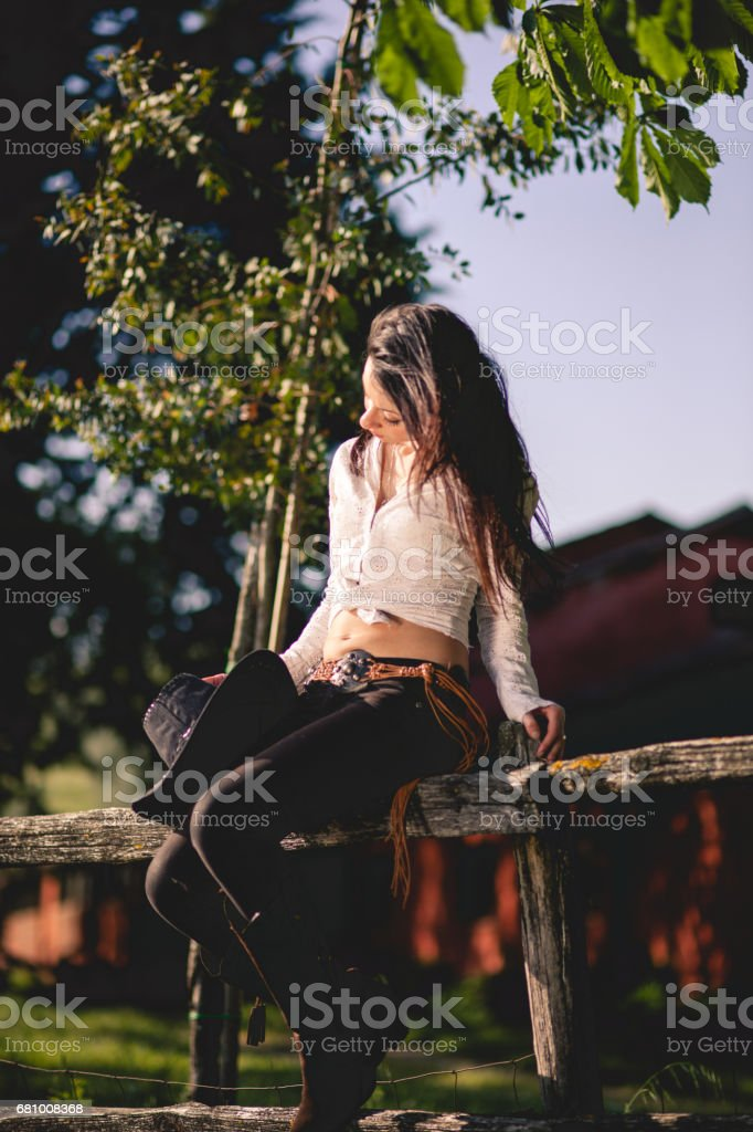 countryside portrait with young woman with cowboy hat royalty-free stock photo