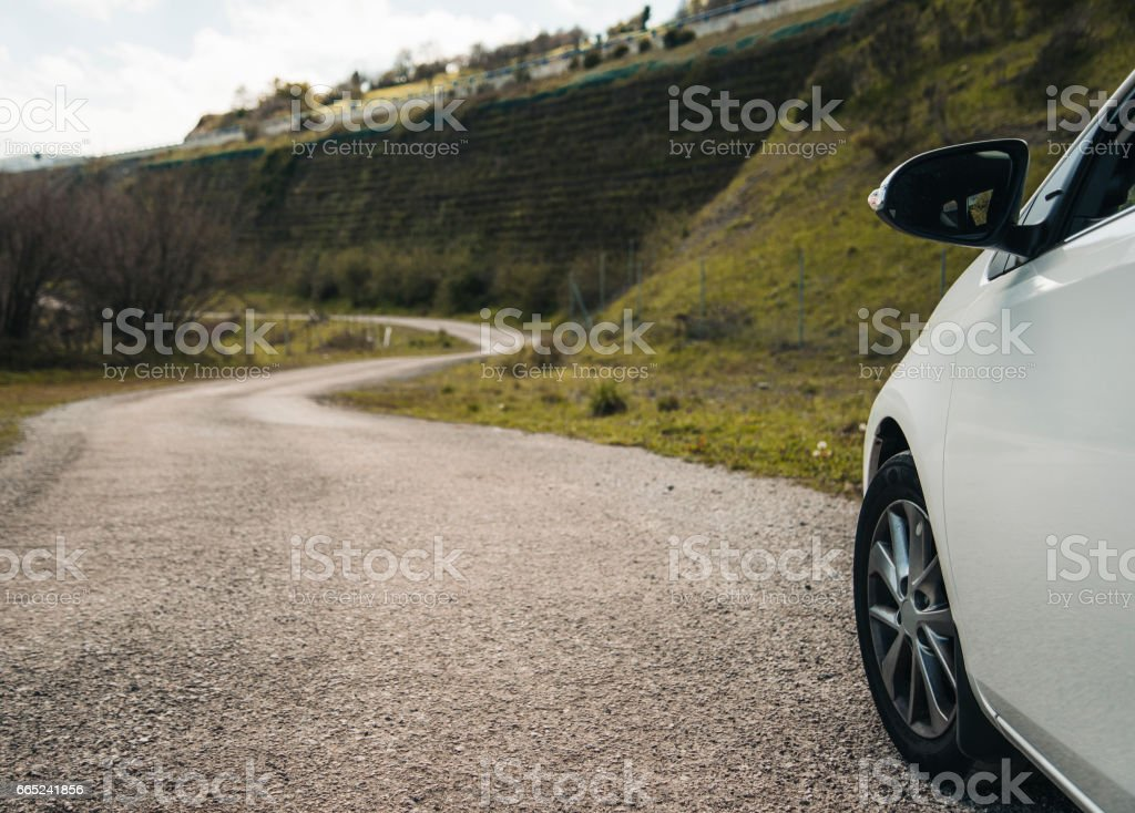 Countryside road and car stock photo