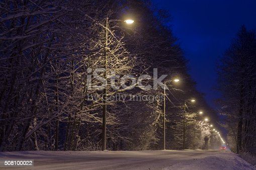 657042754 istock photo Countryside road covered with snow by night 508100022