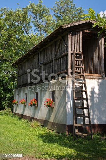 Storage room on the farm on a sunny summer day.