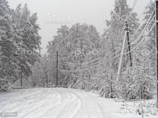 Photo of Countryside street under snowfall
