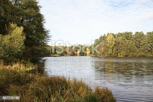 Small countryside village view of river pond lake in late october.