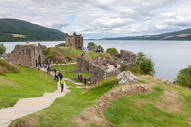 Countryside view of Urquhart Castle beside Loch Ness in UK Urquhart Castle beside Loch Ness in Scotland, UK. inverness scotland stock pictures, royalty-free photos & images