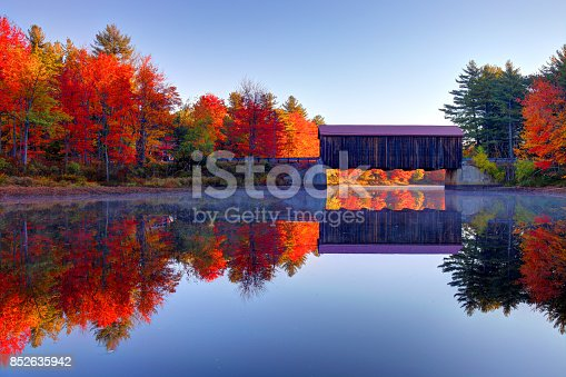 The County Covered Bridge near Greenfield and Hancock, NH during the paek fall foliage season