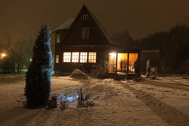County house (dacha) and decorated Christmas tree. Moscow region. Russia. Russian county house (dacha) and decorated Christmas tree. Moscow region. Russia. russian dacha stock pictures, royalty-free photos & images