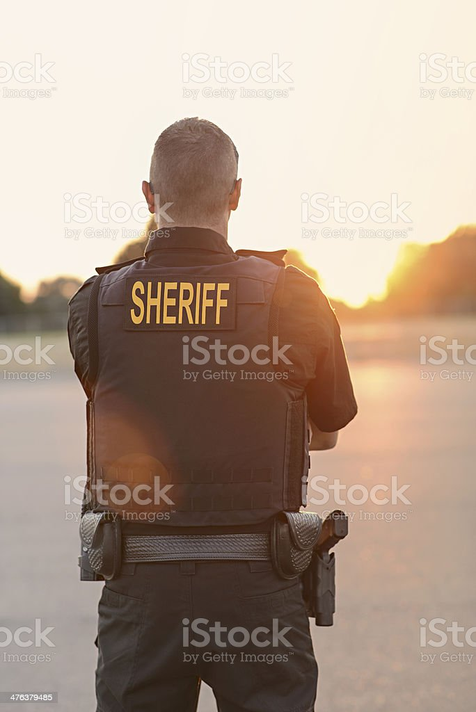 County Sheriff Police Officer at sunset stock photo