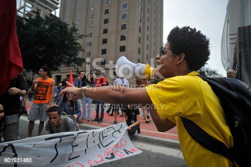 São Paulo, Brazil, September, 11, 2016: Student with a megaphone shouting slogans during act against the coup and calling for new elections and other social agendas for the country
