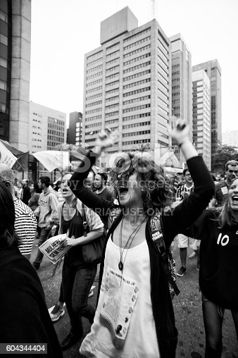 São Paulo, Brazil, September, 11, 2016: Woman shouting slogans during act against the coup and calling for new elections and other social agendas for the country