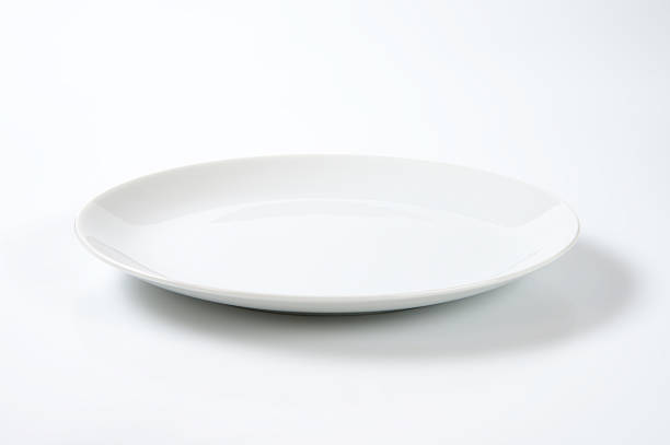 Coup shaped white plate stock photo