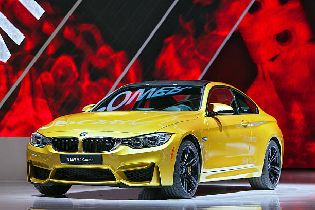 BMW M4 Coupe 2014 Detroit Auto Show Detroit, MI, USA – January 13, 2014:  The World premiere of the new BMW M4 Coupe at the North American International Auto Show in Detroit Michigan. 2014 stock pictures, royalty-free photos & images
