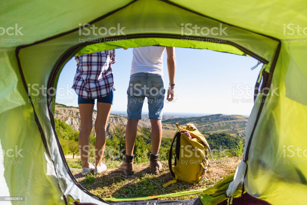 Couple admires the scenery outside the tent royalty-free stock photo