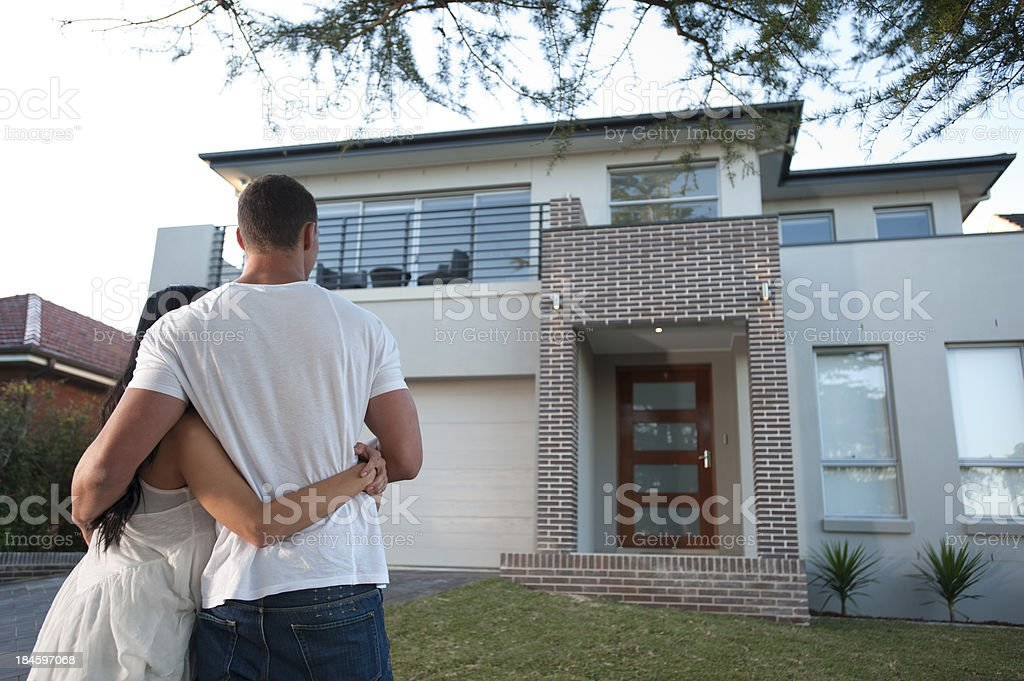 Couple admiring a new house. royalty-free stock photo