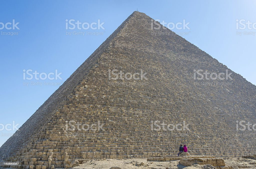 Couple admiring Khufu Pyramid in Giza royalty-free stock photo