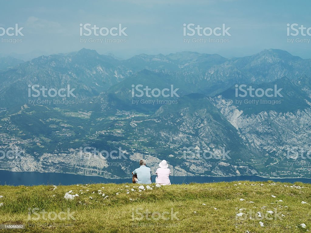 Couple admiring rural hillside view stock photo
