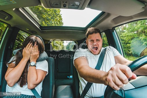 istock couple all most get car accident. not safe driving 1053329144