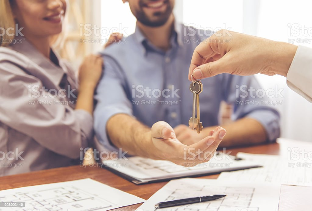 Couple and a realtor stock photo