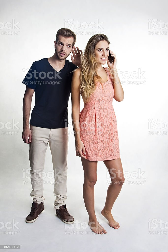 Couple and a suspicious calling royalty-free stock photo