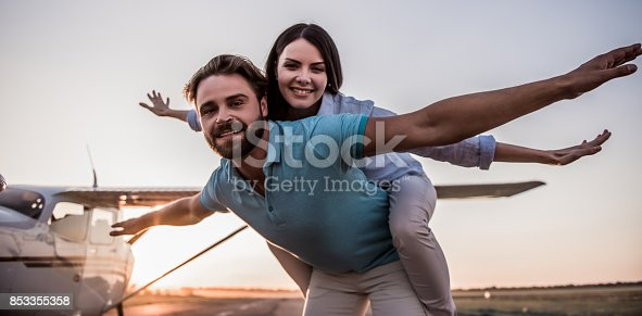istock Couple and aircraft 853355358