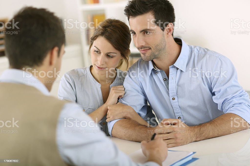 Couple and architect for a meeting in office royalty-free stock photo