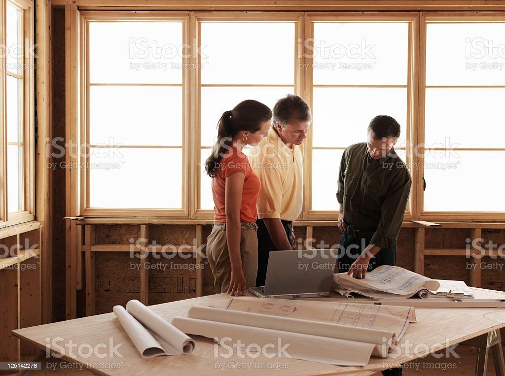 Coppia e Builder - foto stock