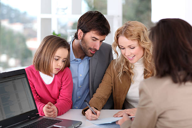 Couple and child buying house stock photo