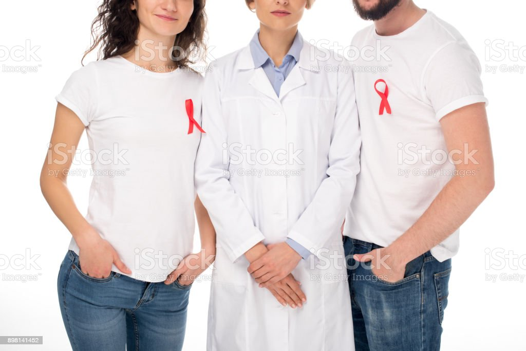 couple and doctor with aids ribbons stock photo
