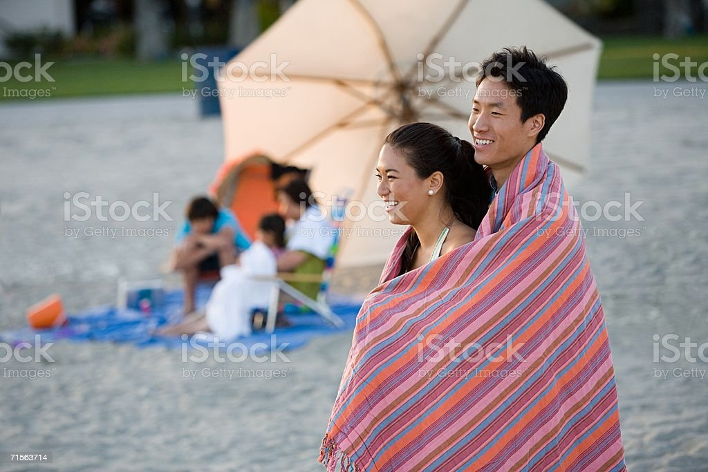 Couple and family on the beach royalty-free stock photo