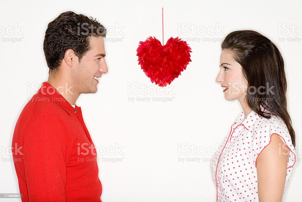 Couple and feather heart royalty-free stock photo