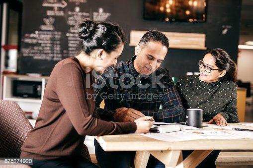 istock Couple and financial advisor 875274920
