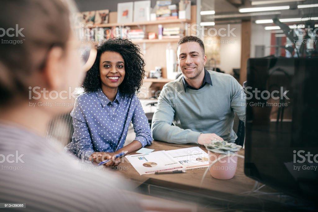 Couple and financial advisor stock photo