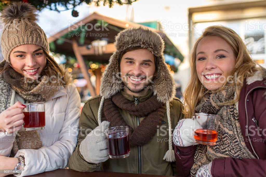 Couple and Friends on the Christmas Market in Germany stock photo