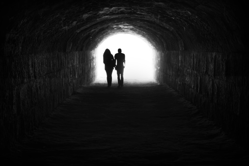 Couple and light in the end of the tunnel