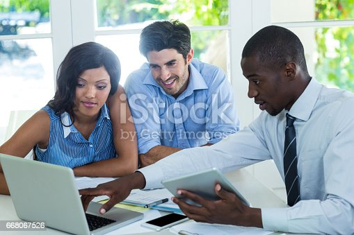 istock Couple and real estate agent discussing together 668067526