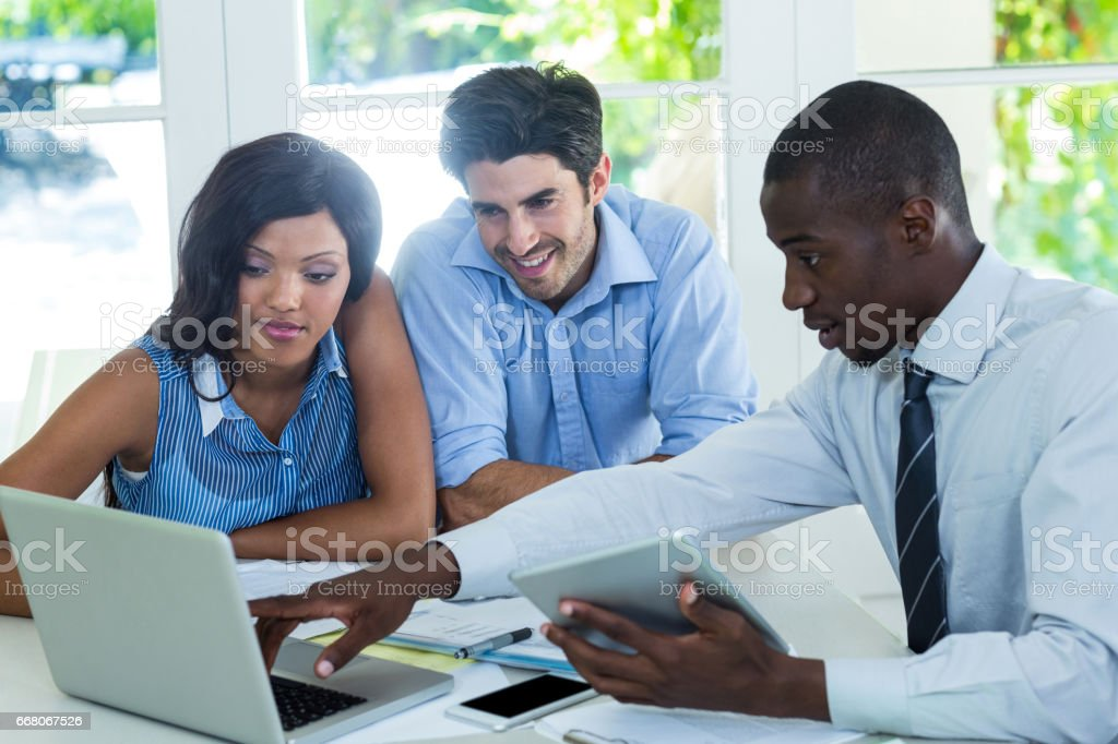 Couple and real estate agent discussing together stock photo