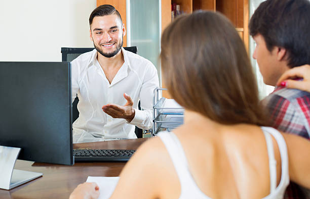 Couple and salesman talking about business Couple and salesman talking about business document in the office kantoor stock pictures, royalty-free photos & images