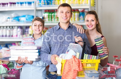 istock couple and teenager with household goods purchase in the store 927781384