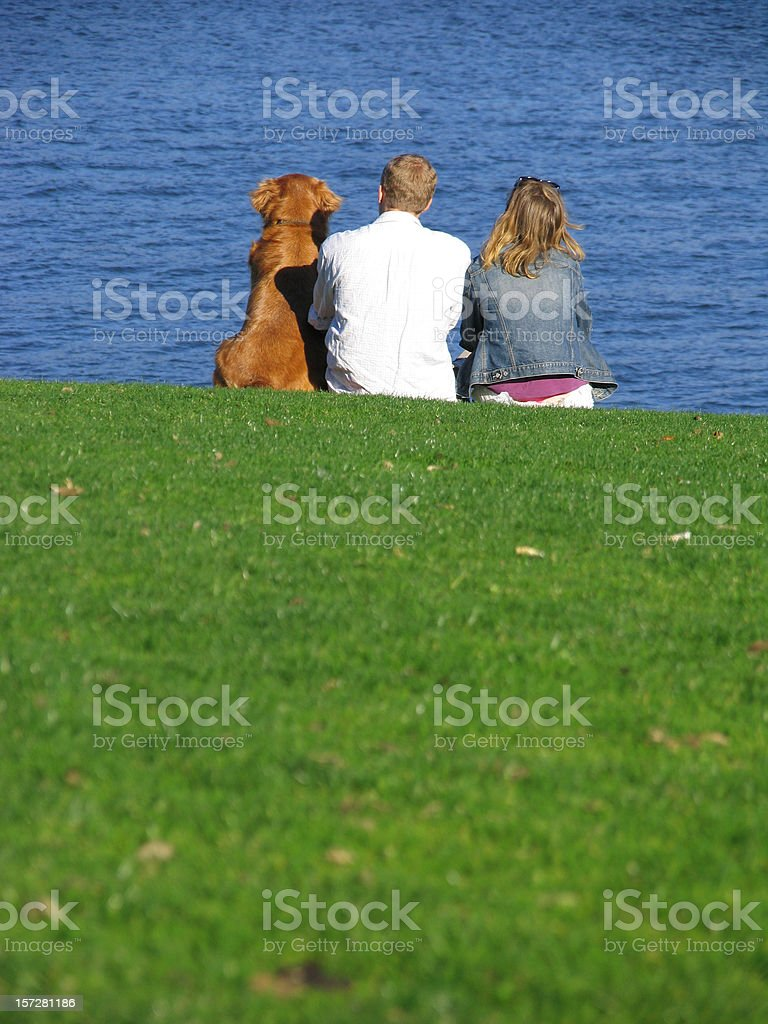 Couple and their Dog by the Waterfront royalty-free stock photo