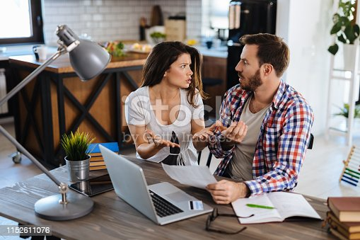 istock Couple arguing about finances 1152611076