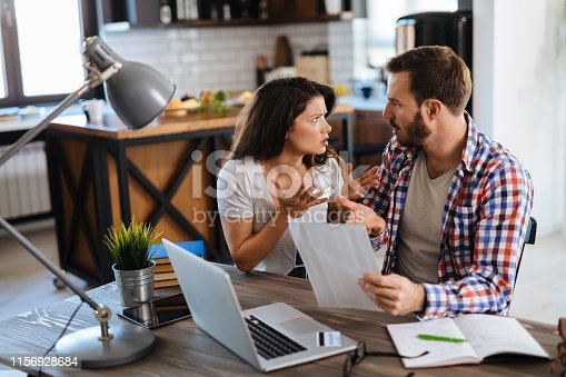 istock Couple arguing about finances 1156928684