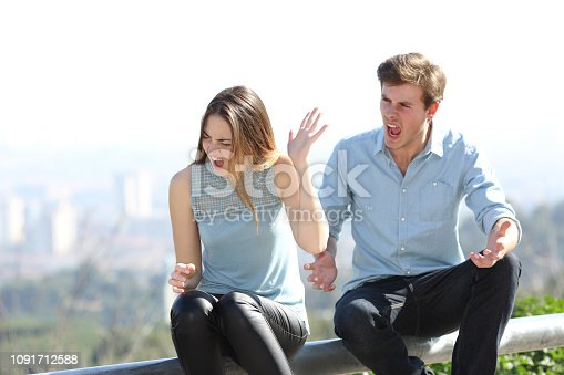 680684660 istock photo Couple arguing in a city outskirts 1091712588